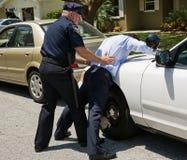 Verbreitungs-Adler auf Polizeiwagen Stockfoto