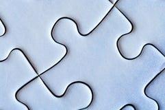 Verbundene Stücke des EinFARBpuzzlespiels nahaufnahme Lizenzfreies Stockfoto