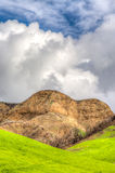Verdant Green Mountains and Hills with Blue Sky and Rolling Clou Stock Image