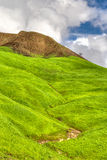 Verdant Green Mountains and Hills with Blue Sky and Rolling Clou Royalty Free Stock Photo