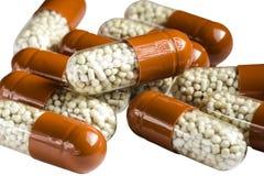Verdauungsfördernde Pillen lokalisiert auf weißem Hintergrund stockfotografie