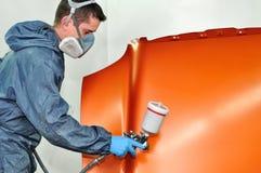 Verde de pintura do trabalhador. Imagem de Stock