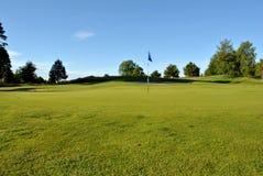 Verde en un campo de golf Foto de archivo libre de regalías