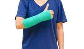 Verde fuso a disposizione e braccio su fondo bianco Immagini Stock Libere da Diritti