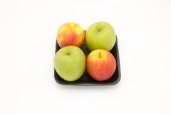 Verde mela e rosso in vassoio nero della schiuma Fotografia Stock