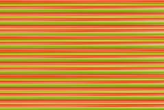 Verde rojo de las rayas horizontales abstractas brillantes del fondo, color de embalaje festivo fotos de archivo