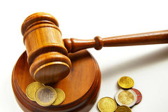 The verdict. Assorted euro coins and a court gavel Stock Images