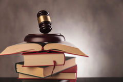 Verdict: education!. Legal system concept. judge's gavel on top of a pile of books Royalty Free Stock Photo