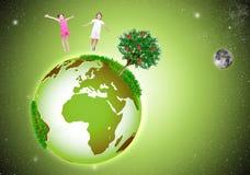 Verdissez la belle terre dans l'espace, avec deux heureux Image libre de droits