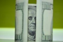 Verdraaide 100 dollarrekening Stock Fotografie