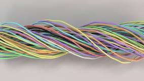 Verdraaide multicolored kabels en draden op witte oppervlakte Stock Afbeeldingen