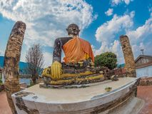 Verdragende Boedha in Wat Phia Wat Xieng Khuang, Laos royalty-vrije stock fotografie