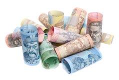 Verdrehte Banknoten von ukrainischen hryvnias auf einem weißen Hintergrund Stockbild