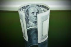 Verdrehter 100 Dollarschein Stockbilder