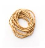 Verdrehtes starkes Seil auf Weiß Stockfotografie