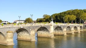 Old and famous bridge in Angers, France. The Verdun bridge in Angers France is a 105 meters long masonry vaulted bridge with two traffic lanes for cars and two stock video footage