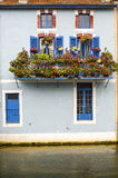 Verdun - House with flowers on the river Stock Photos