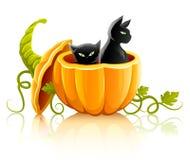 Verdura della zucca di Halloween con i gatti neri Immagini Stock