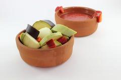 Verdura e pomodoro in pentola calda Fotografie Stock