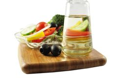 Verdura fresca ed olio Fotografia Stock