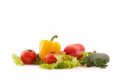 Verdura fresca su priorità bassa bianca Fotografia Stock