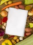 Verduras con el cuaderno Imagen de archivo libre de regalías