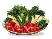 Verduras cortadas en la placa Imagen de archivo