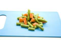 Verduras de la sopa en la placa azul Imagen de archivo libre de regalías