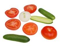Verduras de las cebollas de los pepinos de los tomates en un fondo blanco Foto de archivo libre de regalías