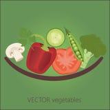 Verduras en frente de la placa Foto de archivo libre de regalías