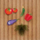 Verduras en la tabla de madera Fotos de archivo libres de regalías