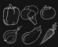 Verduras fijadas en fondo negro Foto de archivo