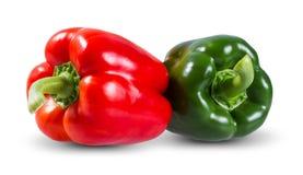 Verduras frescas dos pimientas rojas, verdes dulces Imagen de archivo