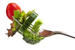 Verduras frescas en una fork Foto de archivo libre de regalías