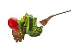 Verduras frescas en una fork Imágenes de archivo libres de regalías