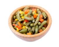 Verduras mezcladas en un cuenco encendido Imagen de archivo