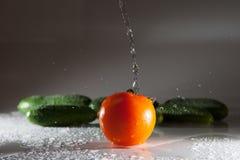 Verduras y agua Imagen de archivo libre de regalías