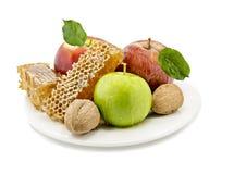 Verduras y miel dulces en blanco Imagen de archivo