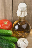 Verduras y una botella de aceite, aún vida Fotos de archivo