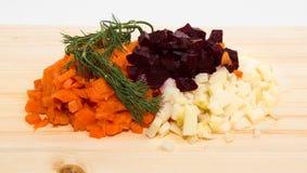Verdure bollite piccolo taglio: le carote, patata, barbabietola e un reggiseno Fotografia Stock Libera da Diritti