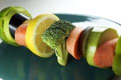 Verdure su uno sputo Fotografie Stock Libere da Diritti