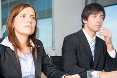 Verdutzen Sie businesscouple Lizenzfreie Stockfotos