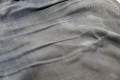 Verdwijn van de oude jeans langzaam Stock Foto