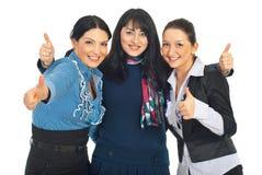 Vereinigte Geschäftsfrauen gibt Daumen stockfoto