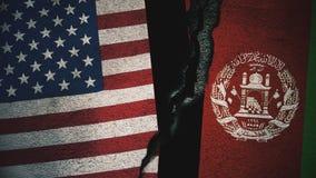 Vereinigte Staaten gegen Afghanistan-Flaggen auf gebrochener Wand Stockbild