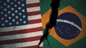 Vereinigte Staaten gegen Brasilien-Flaggen auf gebrochener Wand Lizenzfreies Stockbild