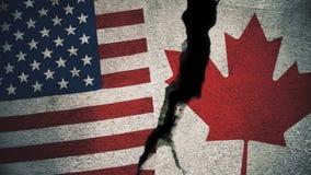 Vereinigte Staaten gegen Kanada-Flaggen auf gebrochener Wand Lizenzfreie Stockfotos