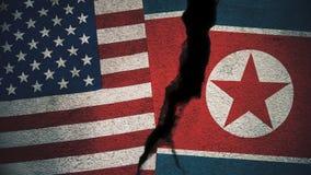 Vereinigte Staaten gegen Nordkorea-Flaggen auf gebrochener Wand Lizenzfreies Stockfoto