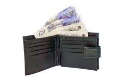 Vereinigtes Königreich zehn und zwanzig Pfund Anmerkungen in einer Geldbörse Lizenzfreie Stockbilder