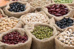 Vereous multicolor dried legumes in sack cloth Stock Image